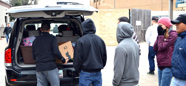 Volunteers dressed warmly on a cold, winter's day at Mission Arlington, unloading warm clothes and blankets for people in need.