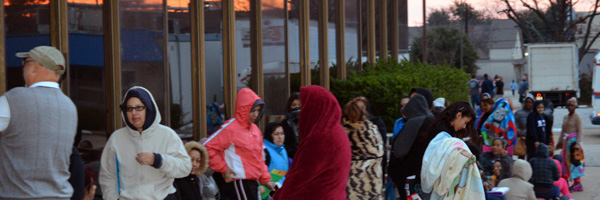 People waiting in line on a cold morning, on the opening day of the Christmas Store last year, in 2014. 32,000 children received toys last year. Strong crowds are expected again, starting today.