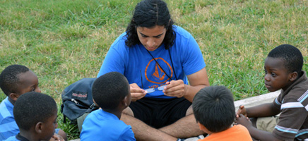 Ceasar, from McAllen, TX, teaches God's word to children at a Mission Arlington summer revival service.