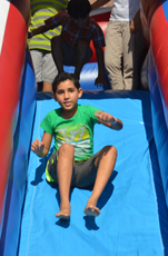 Big Bouncy house slides are a part of the fun at the Fall Festival today. Pictured here, a young boy enjoying the slide at last year's event.