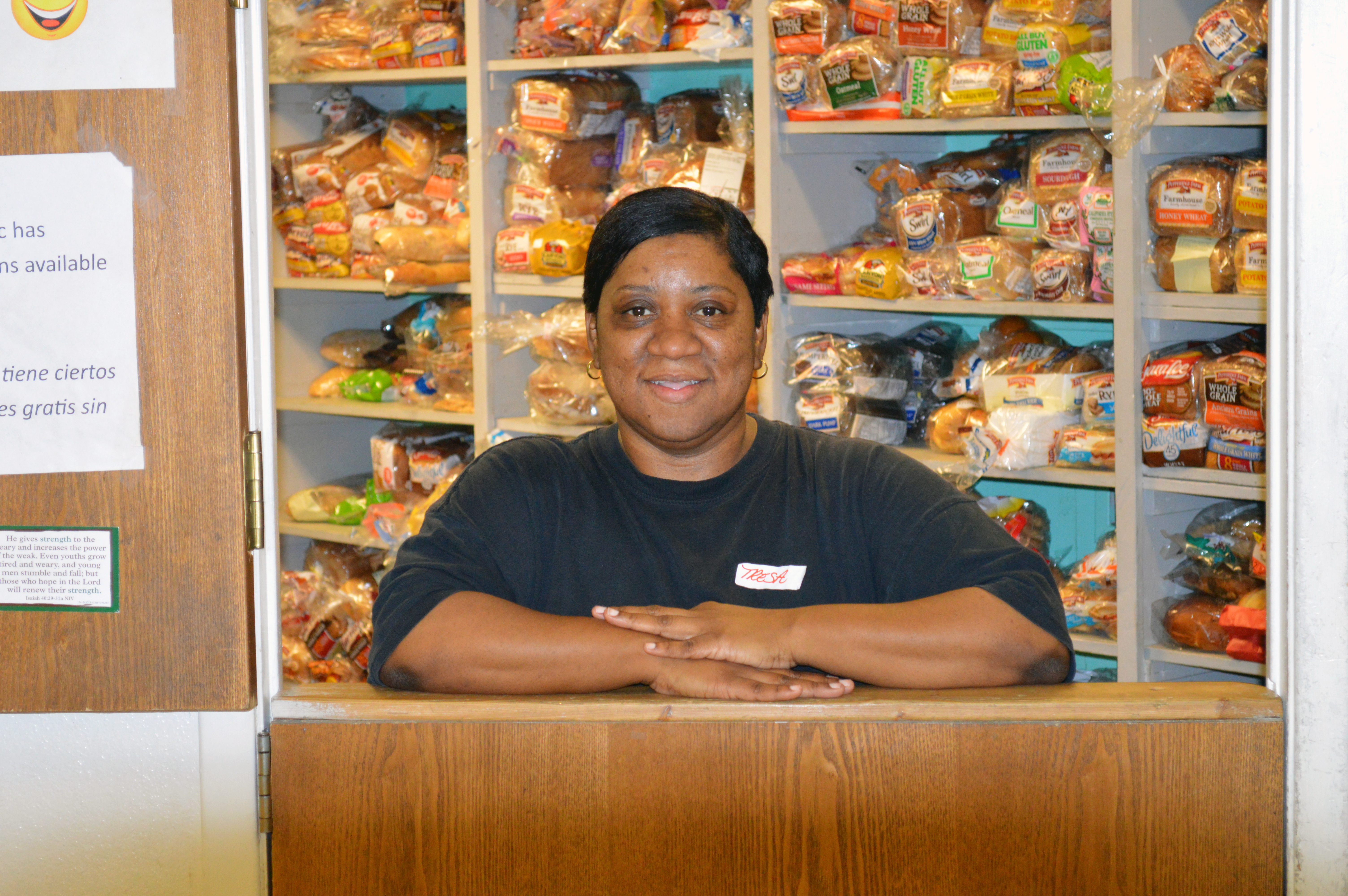 A volunteer works in Mission Arlington's food pantry, helping other get the food they need for their families.