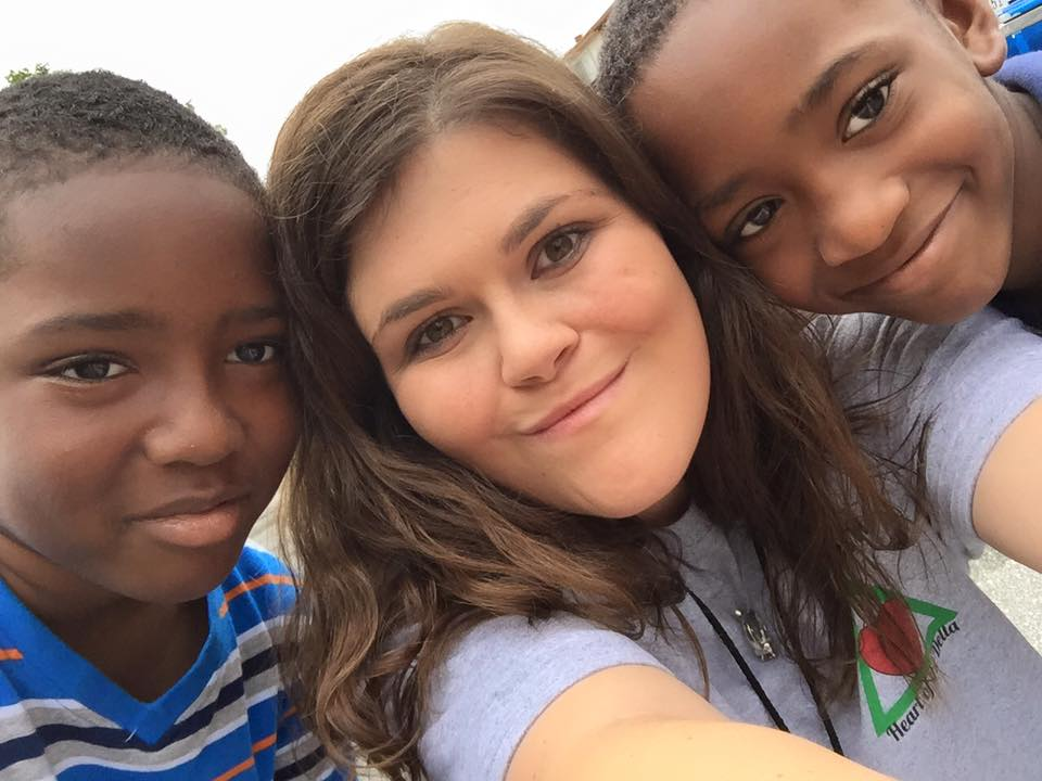 Summer Missionary Robin is pictured here with two children from here ministry. 37 students served with Mission Arlington this summer.