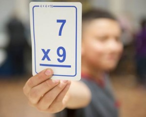 """A student works on his math skills at an """"after-school"""" program in a central Arlington apartment community."""
