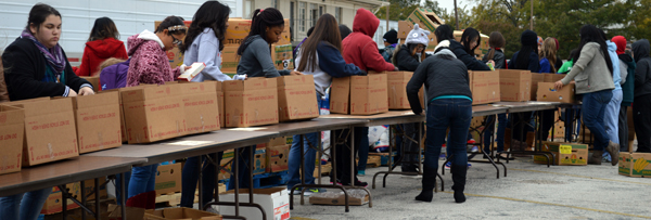 Coble Middle School students putting together Thanksgiving boxes on the same Saturday in 2014.