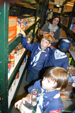 Cub Scouts separating out Thanksgiving food late one night early this week.