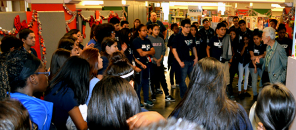 100 students from Arlington Collegiate High School rest from their day of labor at Mission Arlington to take a look at the Christmas Store as it takes shape