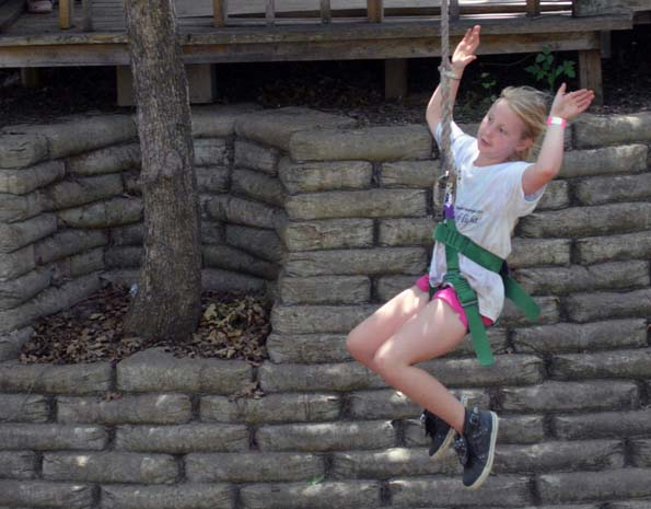 Flying high, having fun, at a Mission Arlington children's camp for 4th, 5th, and 6th graders.