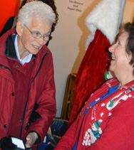 Tillie Burgin Director of Mission Arlington since the beginning, in the Christmas Store talking with a volunteer.