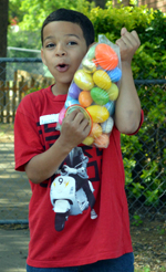 A young man, after the egg hunt, with a bag full of eggs.