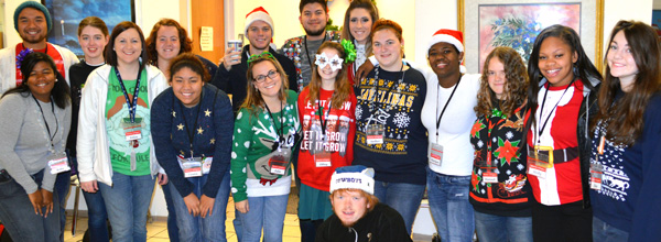 Students from Go Now Missions, from all across Texas, pausing to pose, before the start of another busy day during Mission Arlington's Christmas Season